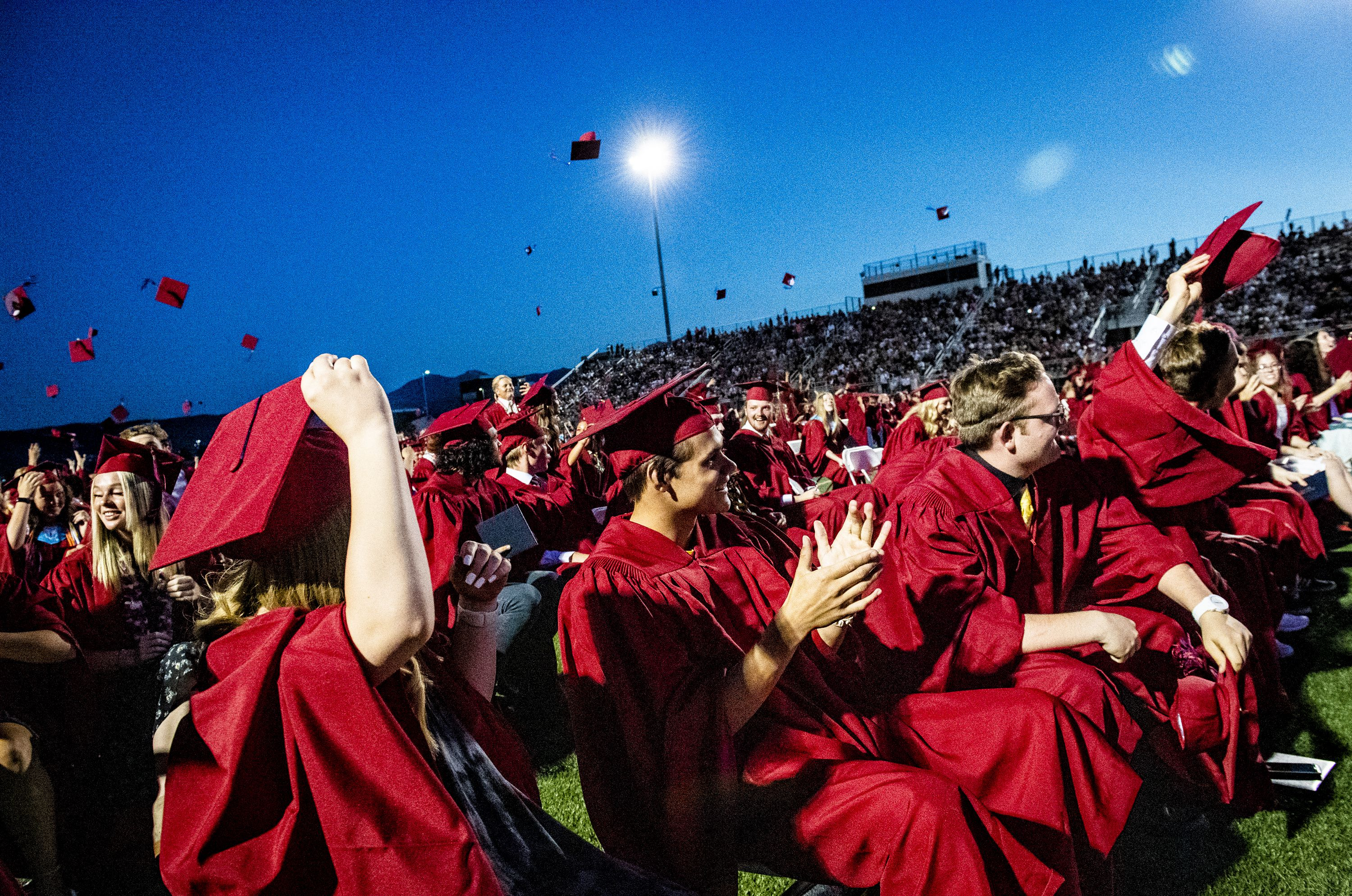 (Isaac Hale | Special to The Tribune) Graduates applaud and throw their caps into the air at the end of Herriman High School's graduation ceremony held Thursday, June 3, 2021.