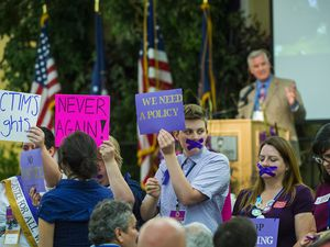 (Chris Detrick  |  Tribune file photo)  Protesters hold up signs and demonstrate as Chairman Peter Corroon speaks during the 2017 Utah State Democratic Party Organizing Convention at Weber State University in Ogden, June 17, 2017. They were protesting against the Democratic Party's response to the allegations against Rob Miller, which the party apologized for on Thursday.