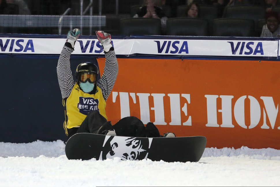 Chris Corning reacts after his final jump in the finals of the Big Atlanta snowboard competition Friday, Dec. 20, 2019, in Atlanta. Corning won the event. (AP Photo/John Bazemore)