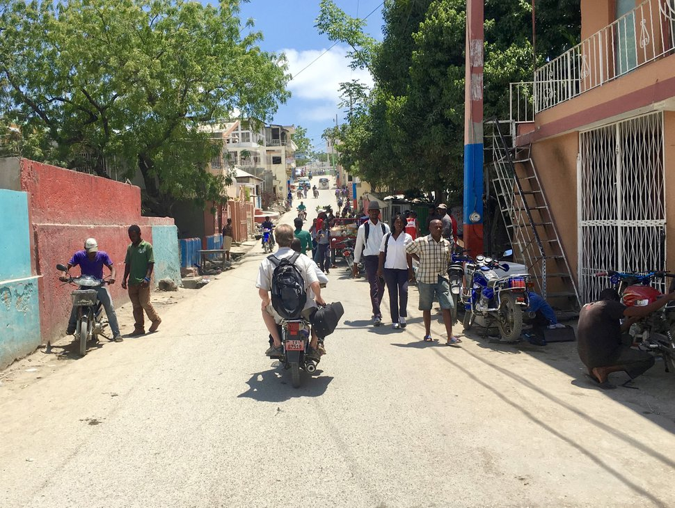 Yuki MacQueen   Courtesy Utah Symphony cellist John Eckstein takes a motorcycle taxi back to his hotel after teaching students in Jacmel, Haiti.