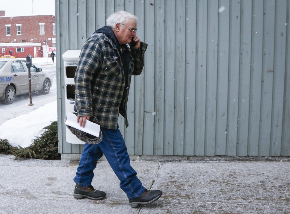 Brandon Blackmore arrives at the courthouse in Cranbrook, British Columbia, Friday, Feb. 3, 2017. Two people linked to the polygamous community of Bountiful, B.C., could have foreseen that their actions would lead to a girl having sex with the church's prophet well before her 14th birthday, a B.C. Supreme Court judge said as he convicted estranged husband and wife Brandon Blackmore and Gail Blackmore Friday. (Jeff McIntosh/The Canadian Press via AP)