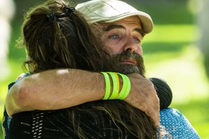 (Rick Egan   The Salt Lake Tribune)  Sean-Paul Schulte, gets a hug from Emily Terris, during a memorial service for Kylen Schulte and Crystal Turner at the Old City Park in Moab, on Friday, Sept. 17, 2021. Sean-Paul is Kylen's father, and Emily used to work with Kylen at the Moonflower Community Co-op in Moab.