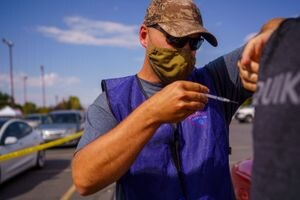 (Trent Nelson     Tribune file photo) Colton Shakespear administers a dose of the Pfizer COVID-19 vaccine at a drive-thru event organized by the Utah County Health Department in Spanish Fork on Friday, Sept. 10, 2021.