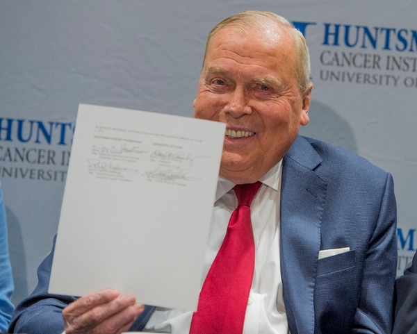 (Leah Hogsten | The Salt Lake Tribune) Jon Huntsman, Sr. is all smiles after the signing of the memorandum. Officials at the University of Utah and Huntsman Cancer Institute have resolved a months-long dispute over management and finances of HCI. The university agreed to pay $68 million to the institute, to be distributed in installments. In return, the Huntsman Cancer Foundation recommitted to providing $120 million in new donations by 2025 and agreed to a detailed formula for how Huntsman Cancer Hospital revenues will be shared with the U. Health Care system and the Huntsman Cancer Institute.