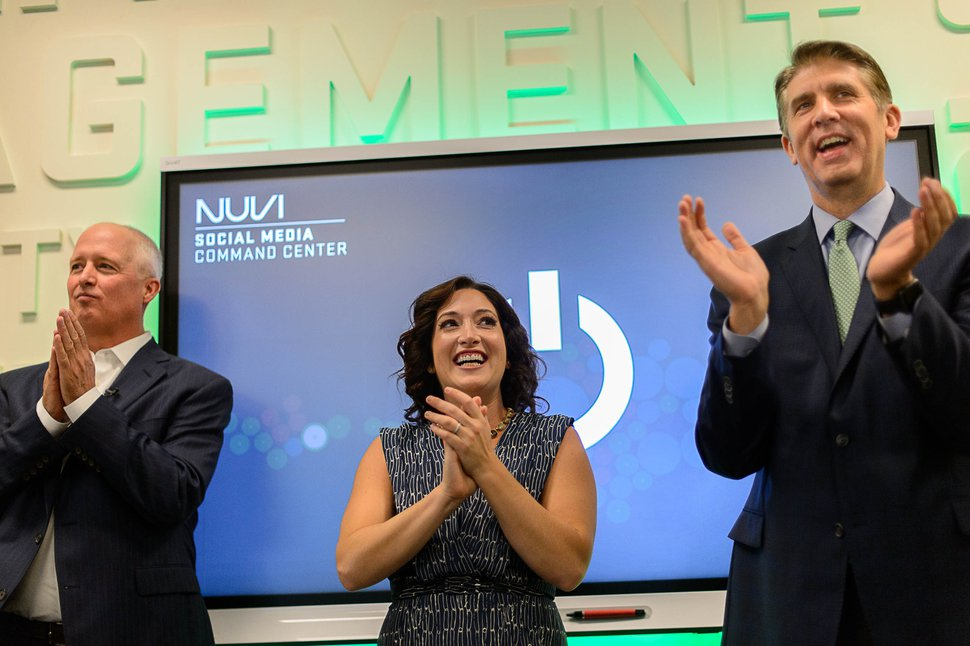 (Trent Nelson | Tribune file photo) NUVI CEO Keith Nellesen, Randi Zuckerberg, and Utah Valley University President Matthew Holland applaud the opening of the NUVI Social Media Command Center at Utah Valley University, Thursday August 31, 2017.