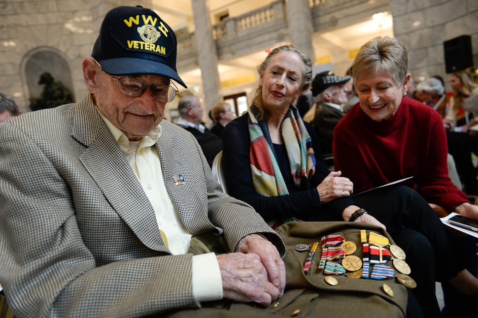 (Francisco Kjolseth | The Salt Lake Tribune) Albert Vise, 100 who was part of the 13th wave on Omaha Beach on D-Day, is joined by his daughters Sharon Parks, center, and Pam Hutchinson as they joins a veterans centenarian celebration honoring over 20 veterans 99 and older in Utah at the State Capitol Rotunda on Tuesday, Nov. 5, 2019.