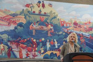 (Francisco Kjolseth  |  The Salt Lake Tribune) Salt Lake City Mayor Jackie Biskupski helps reveal and dedicate a new legacy mural on Monday, Dec. 30, 2019, placed at the Salt Palace to commemorate the 68thÊUnited Nations Civil Society Conference which took place in Salt Lake City in August. The mural was created by Tooele based Digital Gravy which specializes in 2D design-based animation.