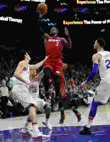 Wade turns back the clock as Miami tops Philly 113-103 to even series