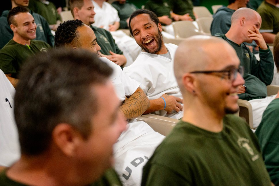 (Trent Nelson | The Salt Lake Tribune) Inmates practice a belly laugh during a motivational talk by Bob Kittell at a meeting of the New Visions Speech Club at the Utah State Prison's Promontory facility in Draper on Tuesday, Dec. 3, 2019.