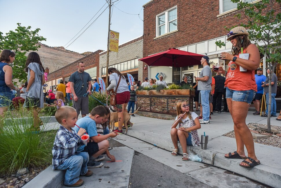 (Francisco Kjolseth | The Salt Lake Tribune) Helper First Fridays draws people to historic Main Street on Friday, Aug. 2, 2019, for their monthly gallery stroll where the small town has been discovered by a variety of artists and dreamers seeking to escape the hustle of the Wasatch Front, lured by cheap real estate prices. Helper today resembles Park City in the late 1960s. Some aging, empty buildings remain, but newcomers joining natives are slowly reinventing the little town of just over 2,000 residents as an artist colony and tourist destination.