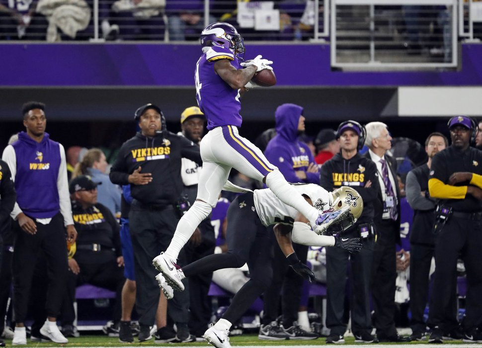 FILE - In this Jan. 14, 2018, file photo, Minnesota Vikings wide receiver Stefon Diggs (14) makes a catch over New Orleans Saints free safety Marcus Williams (43) on his way to the game-winning touchdown during an NFL divisional football playoff game in Minneapolis. The Vikings defeated the Saints 29-24. New Orleans is counting on Williams, a 2017 second-round draft choice, to build on a largely promising rookie campaign that helped solidify the Saints' secondary and propel the club back to the playoffs for the first time in four years. At issue now is how Williams will move forward from the missed tackle on Diggs last January, It's a question that, for now, Williams declines to field. (AP Photo/Jeff Roberson, File)