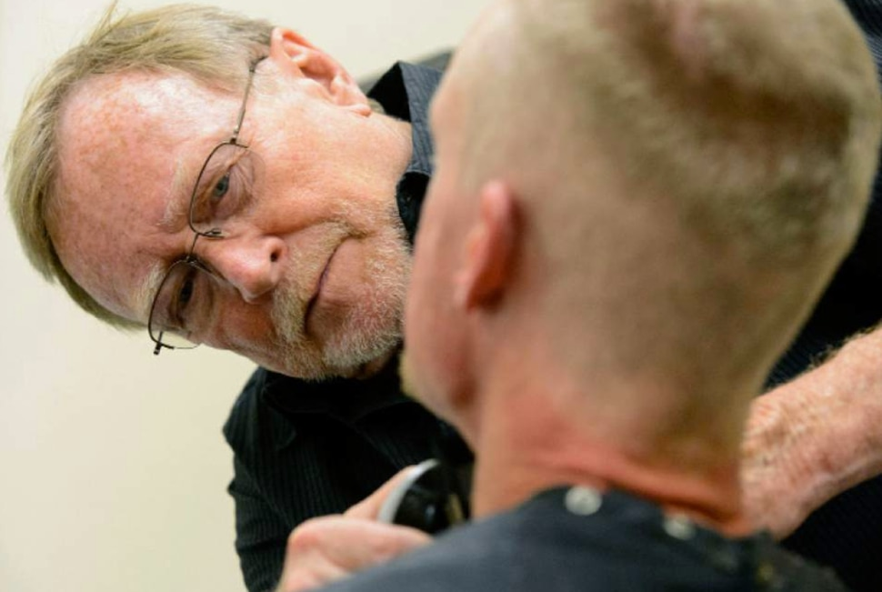 Stuart Stone cuts a man's hair at the Weigand Center in Salt Lake City on Monday, April 17, 2017. Stone as been volunteering his services giving haircuts to homeless individuals for some 20 years.
