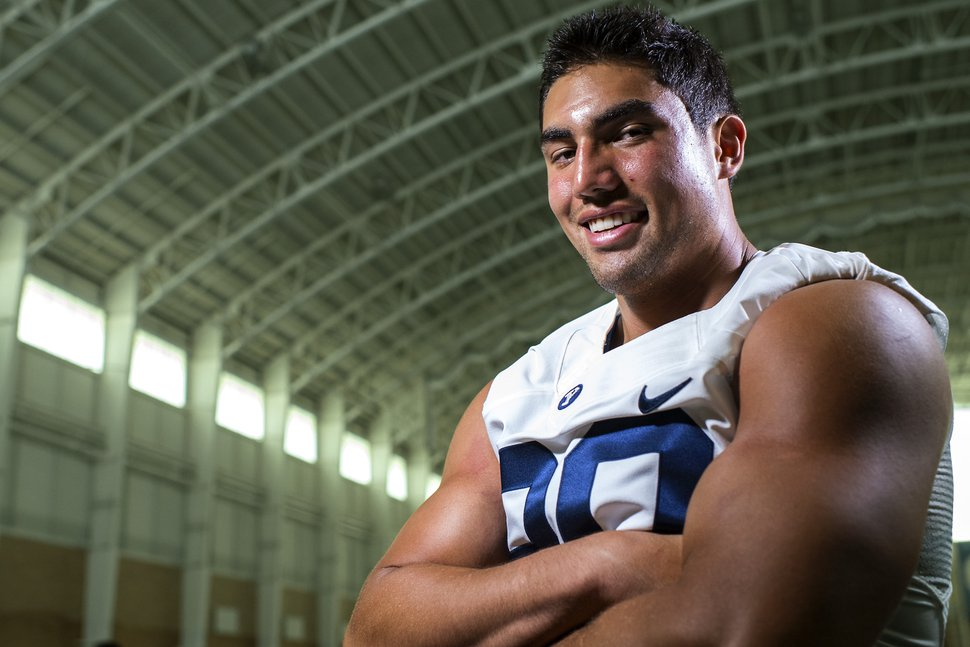 Chris Detrick | The Salt Lake Tribune BYU defensive end Bronson Kaufusi poses for a portrait Wednesday August 12, 2015.