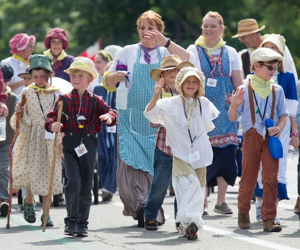 (Rick Egan | The Salt Lake Tribune) Kids from the Bountiful North LDS Stake dress like pioneers as they follow a float with the theme,