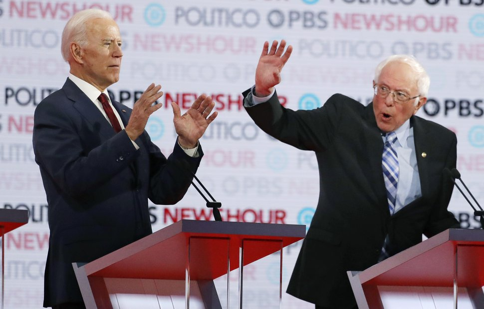 {Chris Carlson | AP file photo) Democratic presidential candidates former Vice President Joe Biden, left, and Sen. Bernie Sanders, I-Vt., speak during a Democratic presidential primary debate on Dec. 19, 2019, in Los Angeles.