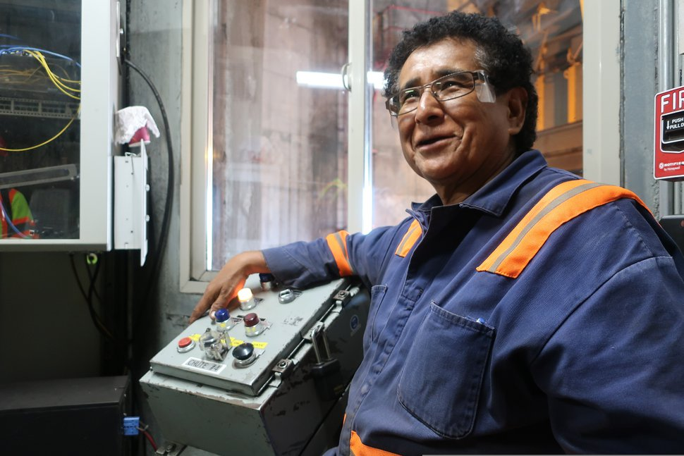 (Felicia Fonseca | AP file photo) Peabody Energy silo operator Gerald Clitso talks with coworkers after loading coal into a train bound for the Navajo Generating Station near Page, Ariz., on Aug. 20, 2019. The power plant will close before the year ends, upending the lives of hundreds of mostly Native American workers who mined coal, loaded it and played a part in producing electricity that powered the American Southwest.