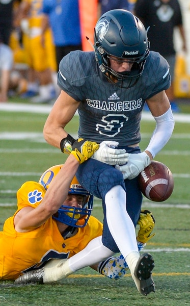 (Leah Hogsten | The Salt Lake Tribune) Corner Canyon's Cody Hagen loses control of the ball as he is tackled by Orem's Buju Tuisavura as Corner Canyon High School hosts Orem High School, Aug. 15, 2019 in Draper.