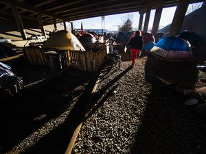 (Rick Egan | Tribune file photo) Camp Last Hope, which was built on abandoned railroad tracks, sits under the freeway for protection from the rain and the snow, Jan. 5, 2021. Utah Gov. Spencer Cox signed a bill Wednesday that will create a full-time state coordinator who's dedicated full time to addressing homelessness in the state.