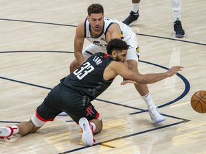 (Rick Egan | The Salt Lake Tribune) Utah Jazz forward Georges Niang (31) knocks the ball out of the hands of Houston Rockets forward Anthony Lamb (33), in NBA action between the Utah Jazz and the Houston Rockets, at Vivint Arena, on Saturday, May 8, 2021.