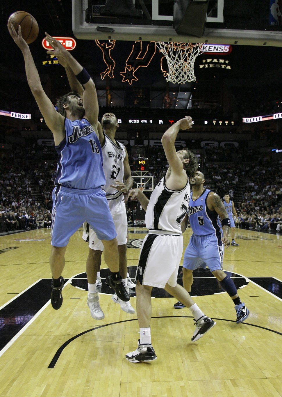 Utah Jazz center Mehmet Okur goes up for a shot in the second quarter of their Western Conference playoff basketball game, Sunday, May 20, 2007, in San Antonio. (AP Photo/Matt Slocum)