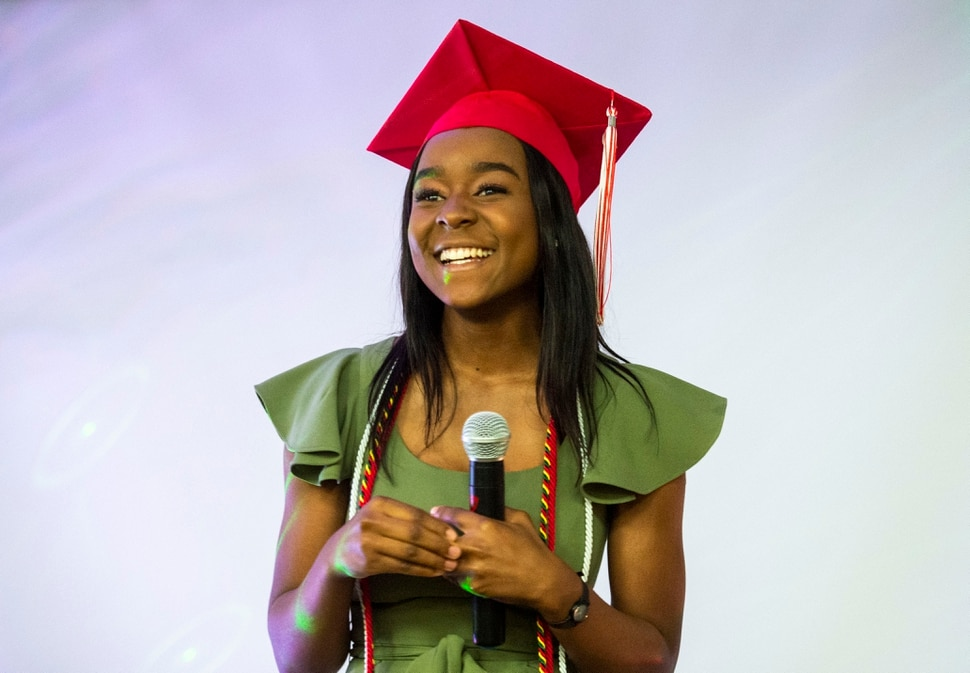 (Rick Egan | The Salt Lake Tribune) Academy of Math, Engineering and Science graduate Sylviane Bahati talks to the crowd during her graduation party. Saturday May 25, 2019