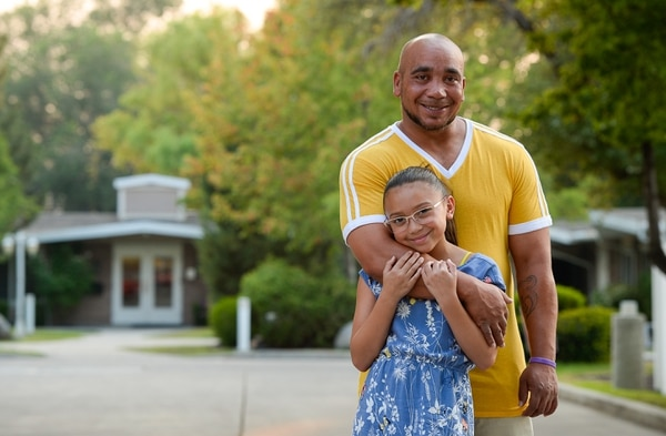 (Francisco Kjolseth | The Salt Lake Tribune) Forging a new path, Carl Henry, pictured with his daughter Heaven, 9, got treatment through an expansion and drug court that happened because of Operation Rio Grande. He's now in sober living run by Odyssey House, and he still volunteers at the Millcreek in-patient center where he got treatment.