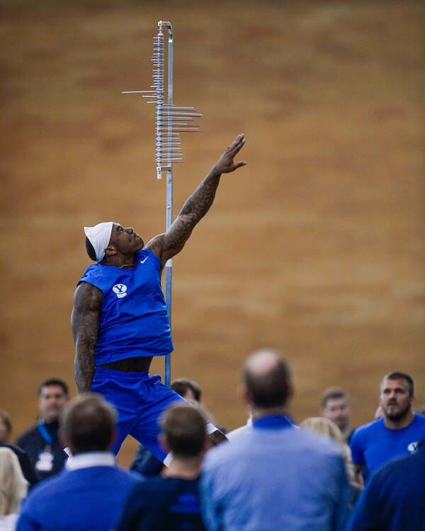 Francisco Kjolseth | The Salt Lake Tribune Running Back Jamaal Williams reaches high for the vertical jump as BYU's Pro Day kicks off at the indoor practice facility with seniors performing in front of NFL scouts.