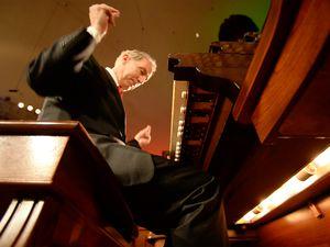 "(Rick Egan  |  The Salt Lake Tribune)  Richard Elliott snaps his fingers as he plays ""Go Tell if on the Mountain"" with his feet."