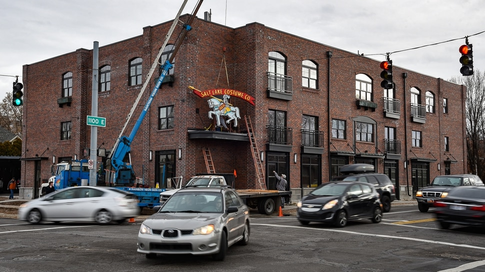 (Francisco Kjolseth | The Salt Lake Tribune) The Salt Lake Costume Co. sign, originally designed by Lloyd S. Coley in the '50s while working for Rainbow Neon Sign Co., lives on once more as it is installed back home in its original location at 1700 S. 1100 East on Monday, Dec. 23, 2019, in what is now called the Salt Lake Costume Apartments.