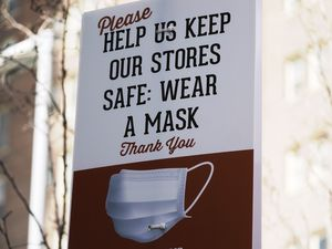 (Rick Bowmer | AP) A sign requiring face masks is seen at Harmons Grocery store Monday, March 8, 2021, in Salt Lake City.