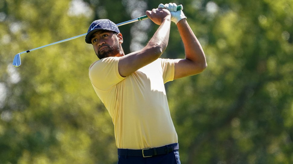 Tony Finau plays his shot from the sixth tee during the third round of the US Open Golf Championship, Saturday, Sept. 19, 2020, in Mamaroneck, N.Y. (AP Photo/John Minchillo)
