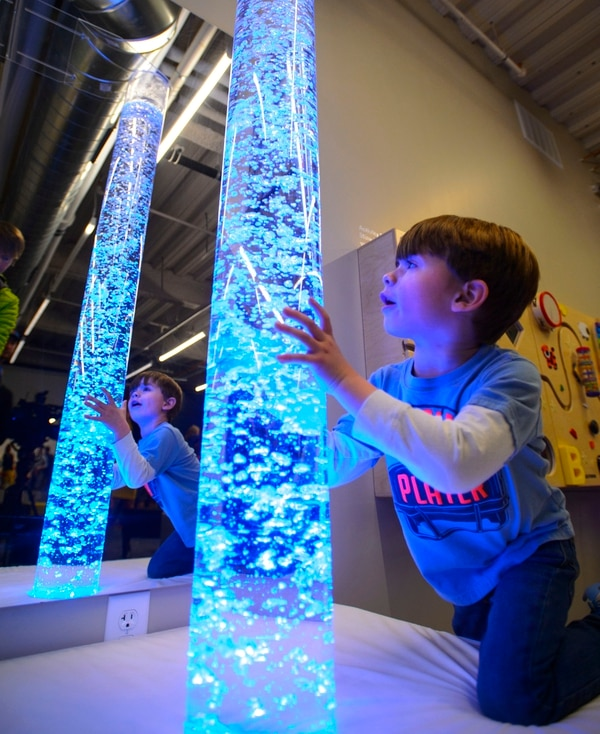 (Steve Griffin | The Salt Lake Tribune) Kylen Hair, age 4, from Orem, enjoys colorful columns of bubbles and water in the new Sensory Room designed and built by Vivint Smart Home and the Utah Jazz inside the arena in Salt Lake City Wednesday March 14, 2018. The sensory room for individuals with intellectual and developmental disabilities opens to the public March 30.