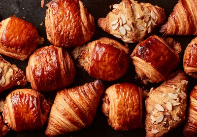 (Johnny Miller | The New York Times) Various croissants are photographed in New York on March 9, 2021. Get those perfectly burnished, flaky pastries straight from your oven with this expert advice.