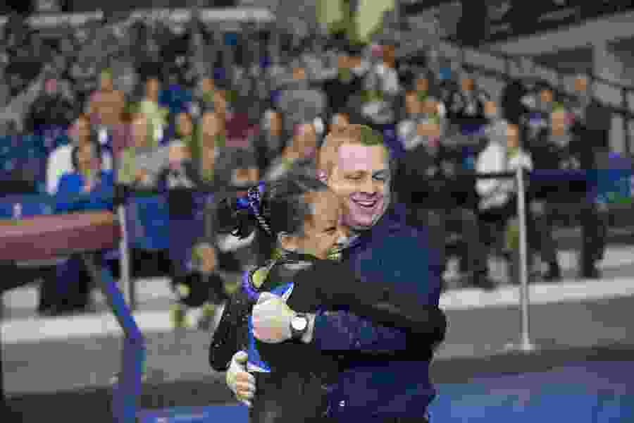 BYU gymnastics coach Guard Young determined to close the gap between Cougars and nationally-ranked Utah
