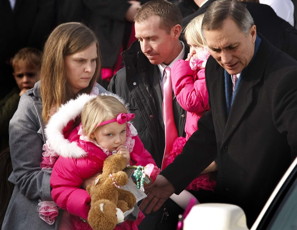 Leah Hogsten | The Salt Lake Tribune Robbie Parker carries daughter Madeline, 4, and Alissa Parker carries Samantha, 2, from the funeral service for their oldest daughter Emilie, Saturday December 22, 2012 in Ogden. Funeral services for Connecticut elementary shooting victim Emilie Parker were held in Ogden at the at the Rock Cliff LDS Stake Center. Emilie, whose family has Ogden roots, was one of 20 children and six adult victims killed in the Dec. 14 mass shooting at Sandy Hook Elementary in Newtown, Conn. The shooting took the lives of 26 people, before the gunman killed himself.