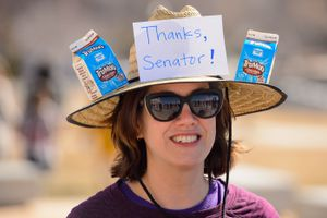 (Trent Nelson  |  The Salt Lake Tribune) Catherine Eslinger at a rally and chocolate milk toast to Sen. Mitt Romney at the state Capitol in Salt Lake City on Friday, Feb. 28, 2020.