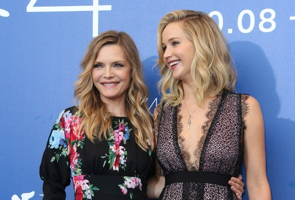 Actresses Michelle Pfeiffer, left, and Jennifer Lawrence pose for photographers at the photo call for the film 'mother!' at the 74th edition of the Venice Film Festival in Venice, Italy, Tuesday, Sept. 5, 2017. (Photo by Joel Ryan/Invision/AP)
