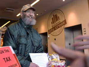 (Leah Hogsten     Tribune file photo) This Jan. 15, 2020, file photo shows volunteer Ron Mortensen at the City Creek Harmons grocery store helping gather voter signatures to put a referendum on the ballot overturning the tax reform package passed by the Legislature. The package included an increase on the food sales tax that was unpopular with grassroots Utahns.