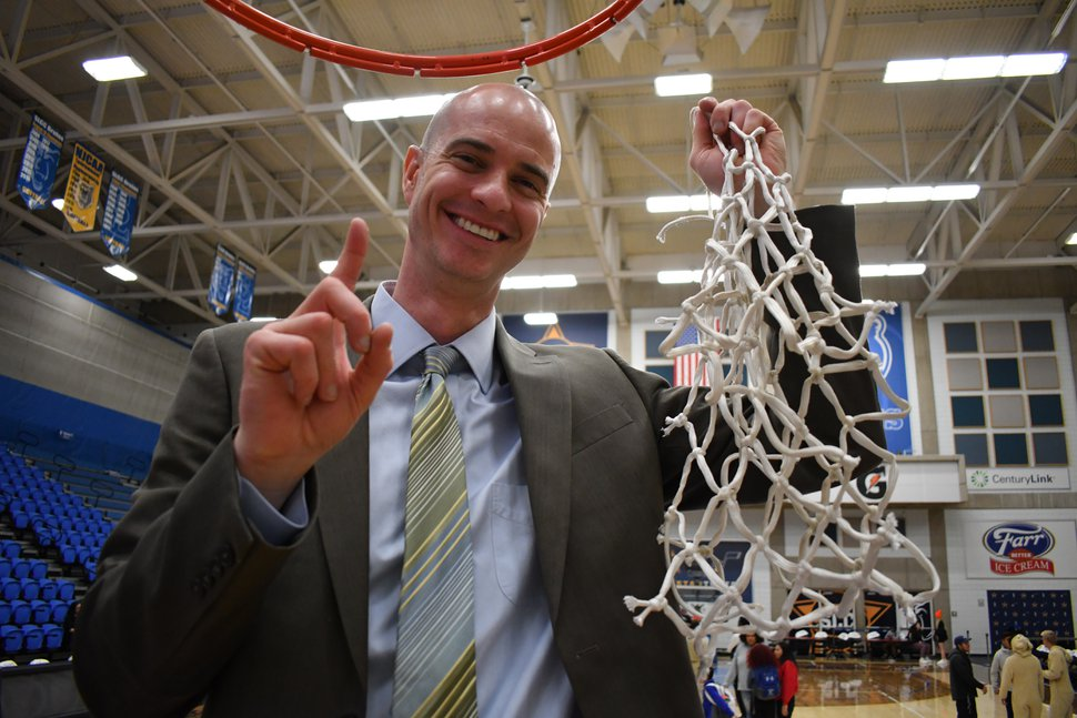 (Photo courtesy of Taylor Munroe | SLCC Athletics) Salt Lake Community College men's basketball coach Kyle Taylor celebrates the Bruins' NJCAA West District Championship win over Eastern Arizona on March 7.