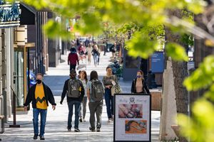 (Francisco Kjolseth | The Salt Lake Tribune) People walk down Main Street in Salt Lake City on Wednesday, April 28, 2021. The Downtown Alliance plans to shut down Main Street to cars three evenings a week starting Memorial Day between South Temple to 400 South from Thursday to Saturday.