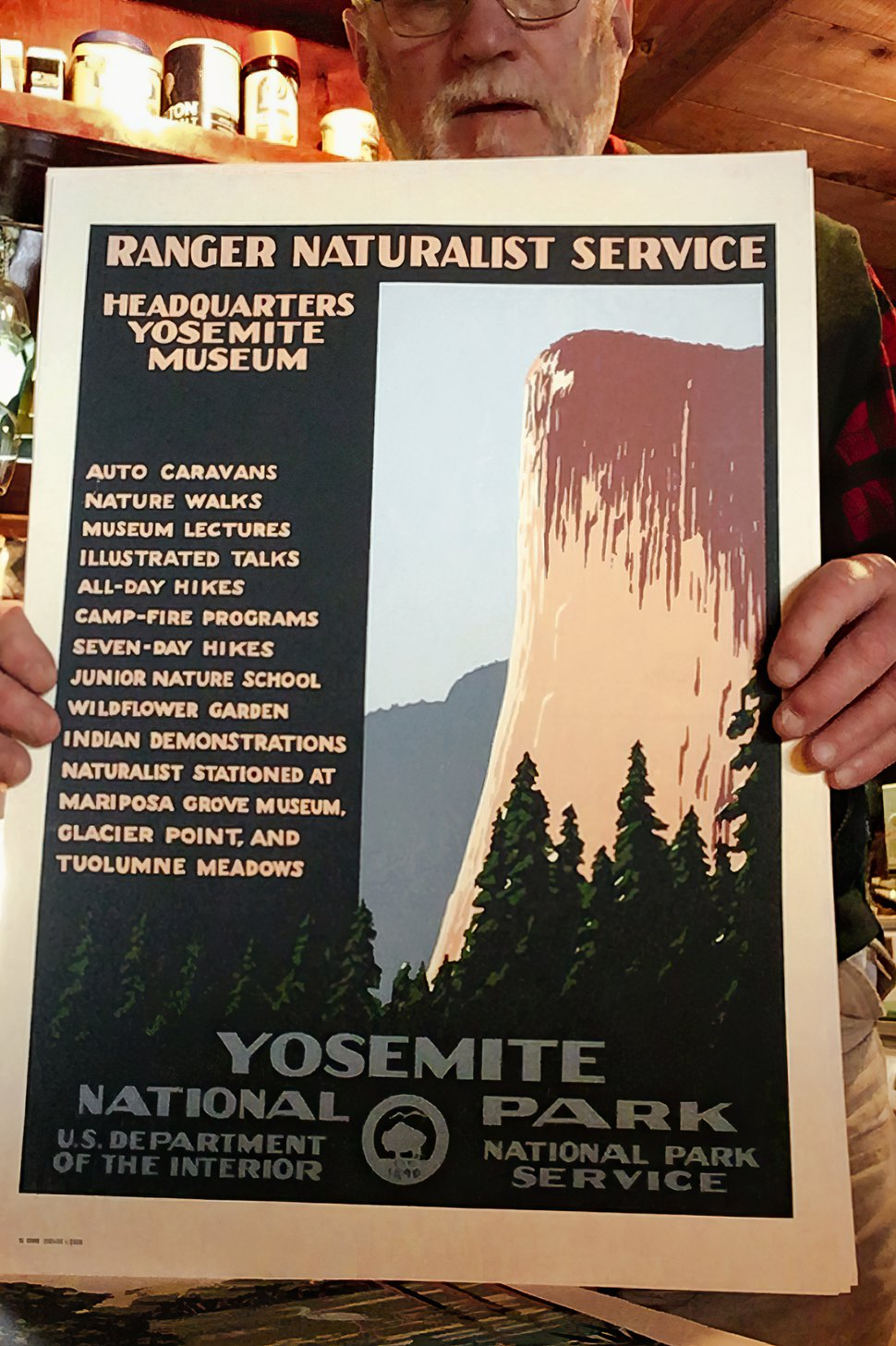 (Annie Tritt | The New York Times) Doug Leen holds a recreation he made of a Works Progress Administration-era Yosemite National Park poster, at his home on Alaska's Kupreanof Island, Aug. 19, 2020. Leen's company, Ranger Doug's Enterprises, reproduces original 1930s WPA national park posters and 32 contemporary designs in the style of the WPA originals.