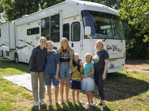 (Rick Egan | The Salt Lake Tribune) The Morris family, Sophie, 15, Euan, 12, Meili, 17, Isaac, 6, Charly 9, and Sidra Morris in front of the RV they have been living in for more than a year, on Tuesday, June 22, 2021.