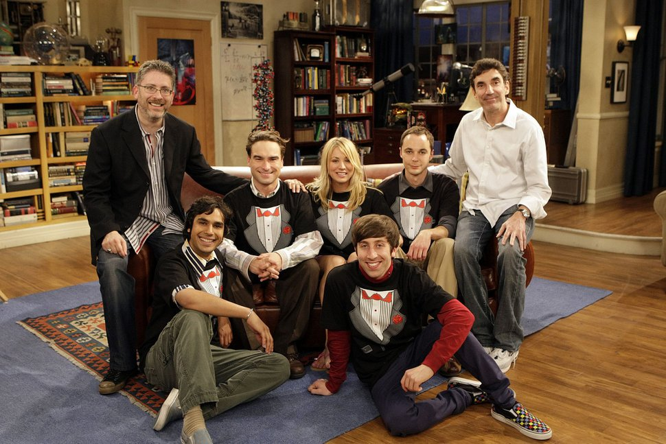 "The cast of ""The Big Bang Theory"" — Kunal Nayyar (second to the left), Johnny Galecki (third from left), Kaley Cuoco (center), Jim Parsons (second from right) and Simon Helberg (foreground, right) — on set with executive producers Bill Prady (far left) and Chuck Lorre (far right). Photo: Sonja Flemming/CBS"
