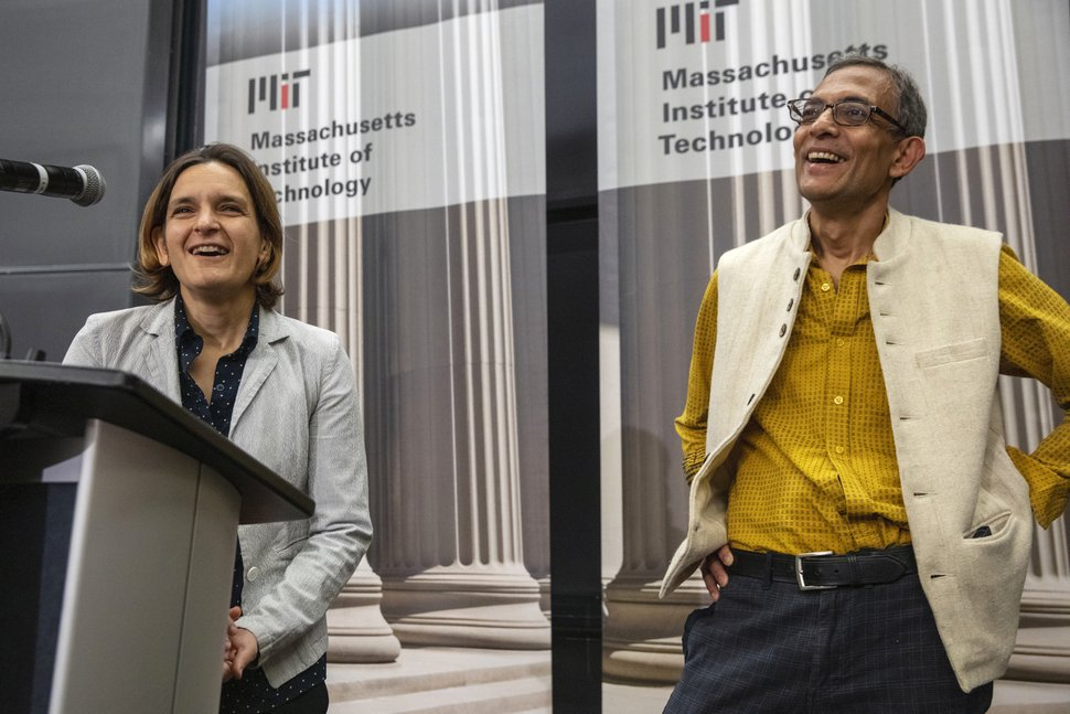 (Michael Dwyer | AP file photo) Esther Duflo, left, and Abhijit Banerjee speak during a news conference at Massachusetts Institute of Technology in Cambridge, Mass., on Monday, Oct. 14, 2019.