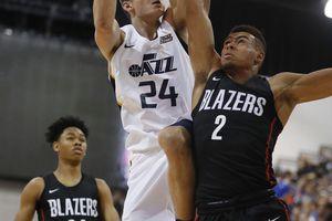 Utah Jazz's Grayson Allen (24) drives into Portland Trail Blazers' Wade Baldwin IV during the second half of an NBA summer league basketball game Saturday, July 7, 2018, in Las Vegas. (AP Photo/John Locher)