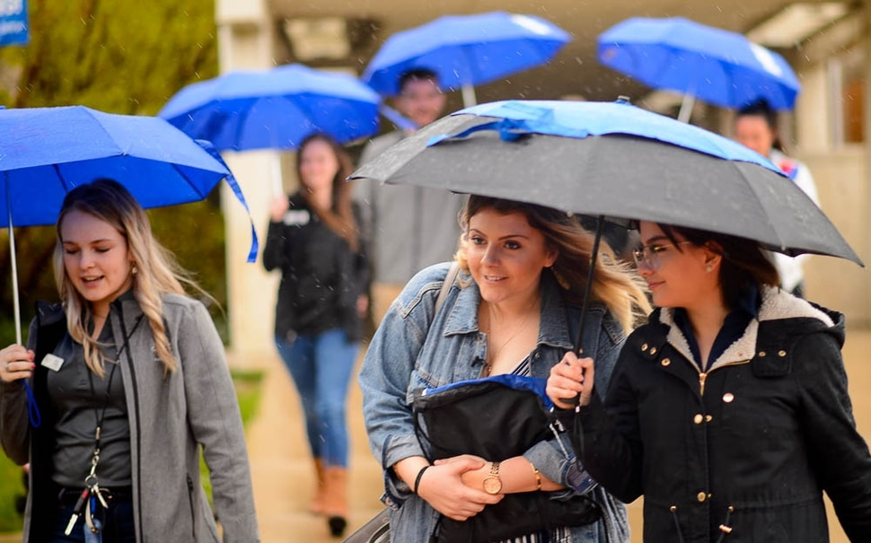 (Trent Nelson | The Salt Lake Tribune) Kaitlynn Lovelady, at center, on a tour of Salt Lake Community College in Taylorsville on Monday April 15, 2019. Lovelady accidentally applied to SLCC instead of a college in Louisiana, where she lives. The Utah school, though, isn't letting it go without a fight. They're taking her on a tour to try to convince her to come here anyway. From left are Alexa Anglin, Lovelady, and Valeria Ampuero.