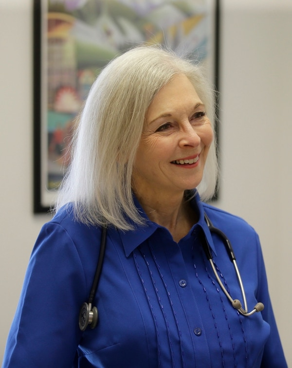 FILE--In this March 14, 2017, file photo, Utah democratic U.S. House candidate Dr. Kathryn Allen speaks during an interview at a clinic in Salt Lake City. New campaign finance reports show that Allen significantly outpaced incumbent Republican Rep. Jason Chaffetz in fundraising last quarter. (AP Photo/Rick Bowmer, file)