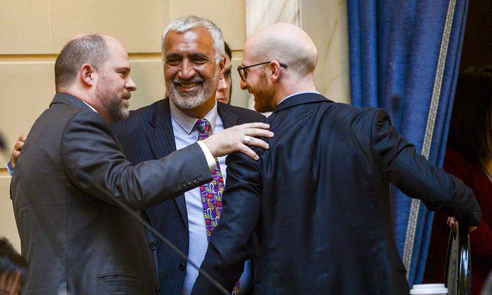 (Leah Hogsten | The Salt Lake Tribune) l-r Daniel Thatcher, R- West Valley City, celebrates the initial approval of his hate crimes bill with Salt Lake County District Attorney Sim Gill and Sen. Derek Kitchen, D-Salt Lake City.
