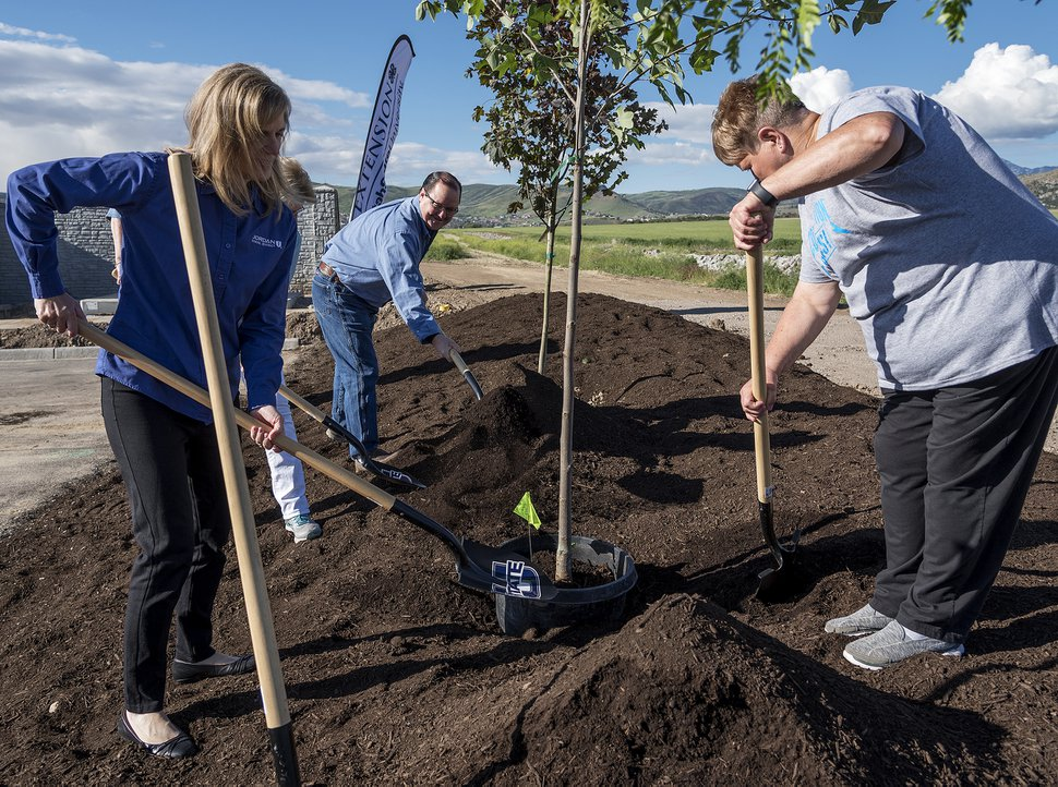 (Michael Mangum | Special to the Tribune) Jordan School District Board of Education members Tracy Miller, left, Darrel Robinson, center, and Marilyn Richards shovel dirt during a tree planting ceremony at the site of the proposed Olympia Hills development project in Herriman, UT on Saturday, June 22, 2019.