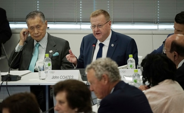 International Olympic Committee (IOC) Vice President John Coates, right top, delivers opening remarks during the IOC Coordination Commission opening plenary for the Olympic Games Tokyo 2020 in Tokyo Wednesday, June 28, 2017. (AP Photo/Eugene Hoshiko)